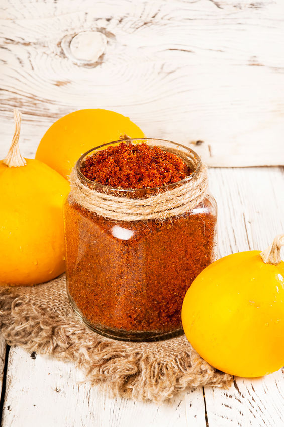 58821830 - homemade sugar scrub with a pumpkin on a wooden background